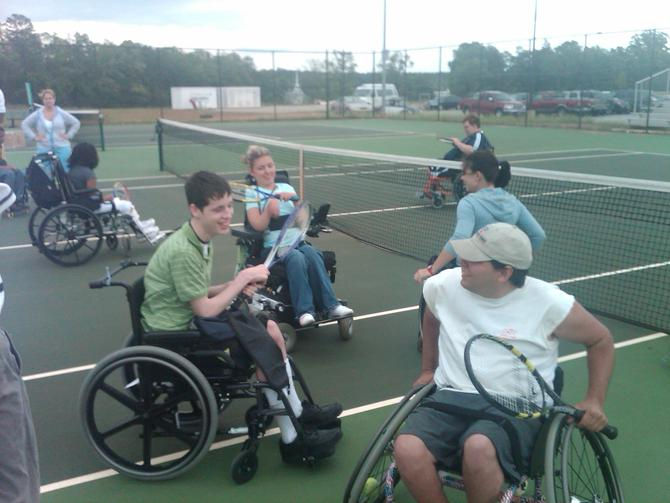 Travis [in the white shirt] loves hitting the tennis courts with his friends in Greenville, SC!