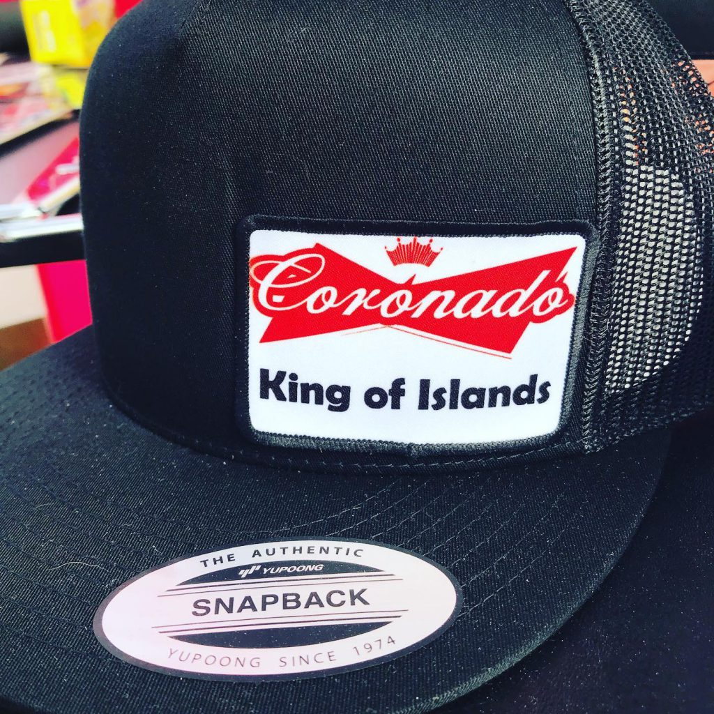 "A hate with a patch that reads, ""Coronado, King of Islands."""