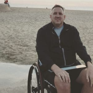 Stefan Freeman sitting in his wheelchair at the beach.